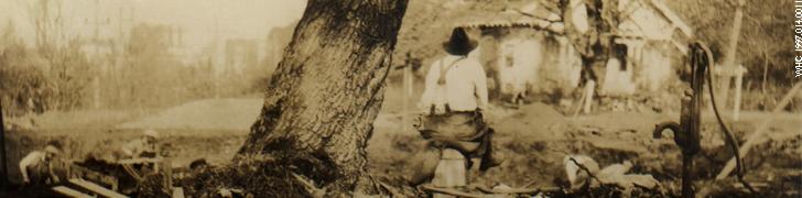 Man next to tree. 19970140011