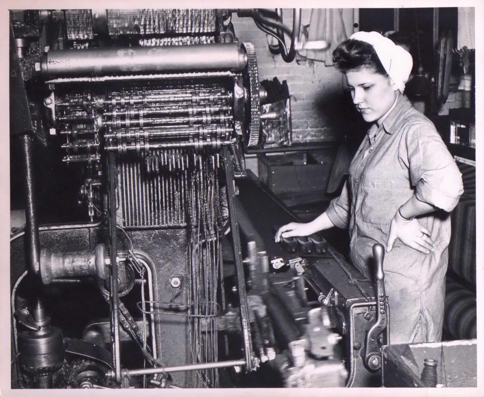 A woman works in the Thomas Kay Woolen Mill at the Willamette Heritage Center
