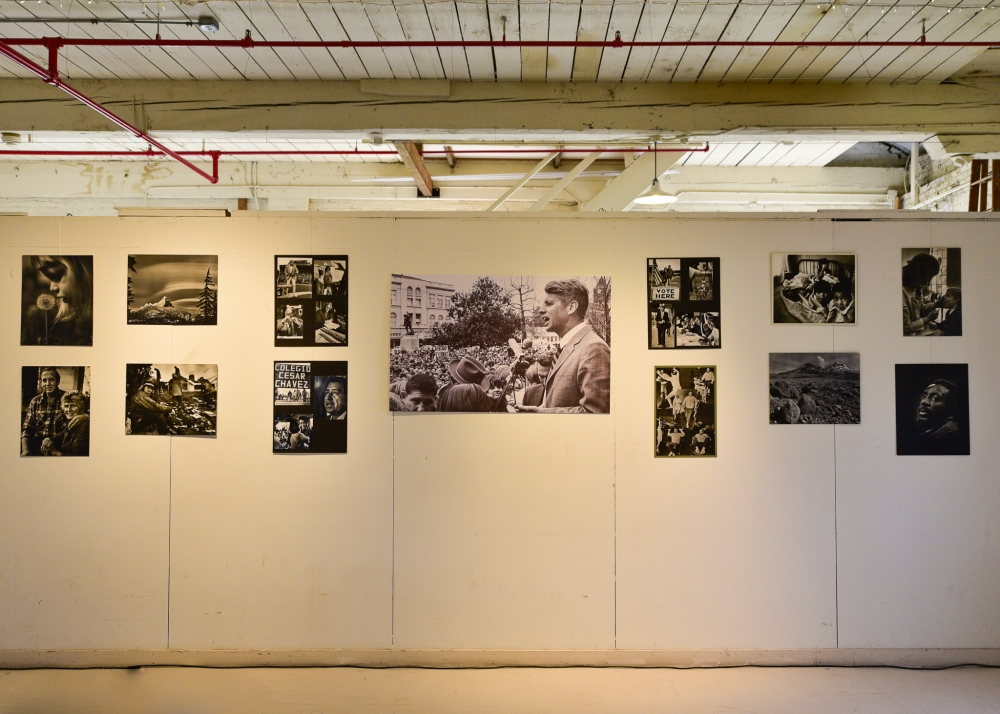 wall displaying black and white prints of gerry lewin photography